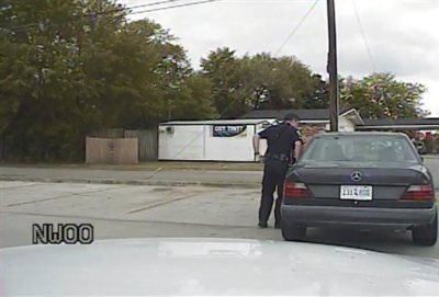 In this April 4, 2015, frame from dashboard video provided by the North Charleston Police Department, Patrolman Michael Thomas Slager stands by Walter Lamer Scott's car during a traffic stop in North Charleston, S.C. The video captures the moments leading up to a fatal shooting that has sparked outrage as the latest example of a white police officer killing an unarmed black man. Slager has been fired and charged with murder. (AP Photo/North Charleston Police Department)