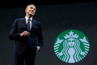 In this March 18, 2015 file photo, Starbucks CEO Howard Schultz speaks at the coffee company's annual shareholders meeting in Seattle. Starbucks will report earnings Thursday April 23, 2015. (AP Photo/Ted S. Warren, File)