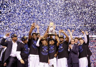 Duke players celebrate with the trophy after their 68-63 victory over Wisconsin in the NCAA Final Four college basketball tournament championship game Monday, April 6, 2015, in Indianapolis. (AP Photo/David J. Phillip)
