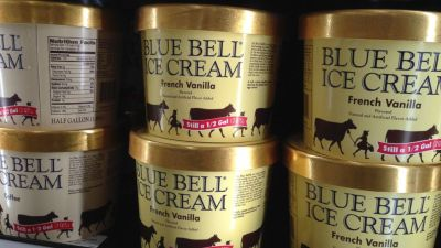 In this April 10, 2015, file photo, Blue Bell ice cream rests on a grocery store shelf in Lawrence, Kan. Texas-based Blue Bell Creameries issued a voluntary recall Monday, April 20, 2015, for all of its products on the market after two samples of chocolate chip cookie dough ice cream tested positive for listeriosis. (AP Photo/Orlin Wagner, File)
