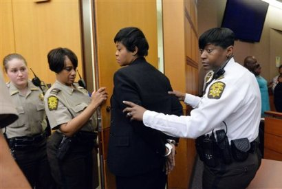Former Deerwood Academy assistant principal Tabeeka Jordan, center, is led to a holding cell after a jury found her guilty in the Atlanta Public Schools test-cheating trial, Wednesday, April 1, 2015, in Atlanta. Jordan and 10 other former Atlanta Public Schools educators accused of participating in a test cheating conspiracy that drew nationwide attention were convicted Wednesday of racketeering charges. (AP Photo/Atlanta Journal-Constitution, Kent D. Johnson, Pool)