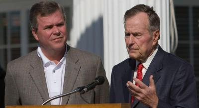 Florida Gov. Jeb Bush, left, listens as former President George H. W. Bush offers condolences to the Ford family during a news conference in remembrance of former President Gerald R. Ford at the Gasparilla Inn in Boca Grande, Fla., Wednesday, Dec. 27, 2006. (AP Photo/Armando Solares)