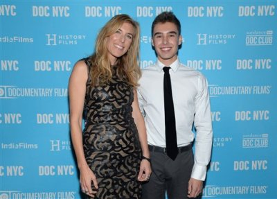 """In this Nov. 14, 2014 file photo, director Amy Berg poses with Evan Henzi from the film, at the world premiere of """"An Open Secret"""" during DOC NYC at the SVA Theater, New York. Documentary 'An Open Secret' by Amy Berg, screens at the 68th international Cannes film festival. (Photo by Evan Agostini/Invision/AP, File)"""