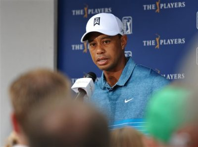 Tiger Woods talks with the media after a practice round for The Players Championship golf tournament in Ponte Vedra Beach, Fla., Tuesday, May 5, 2015. (William Dickey/The Florida Times-Union via AP)