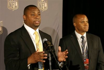 Troy Vincent, NFL executive vice president of football operations, left, speaks next to Rick Smith, Houston Texans Executive Vice President of Football Operations and General Manager at the NFL's spring meetings in San Francisco, Tuesday, May 19, 2015. (AP Photo/Jeff Chiu)