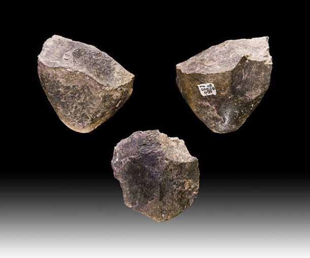 """Found in Etihiopia, these 2.6 million year old Oldowan stone """"choppers,"""" used to hack through meat, wood, and dirt, were previously considered among the earliest human tools. (Didier Descouens/CC BY-SA 4.0)"""