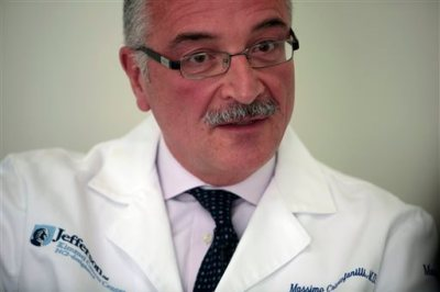 "Dr. Massimo Cristofanilli, oncologist and director of the Breast Care Center, speaks during an interview at Jefferson University Hospital in Philadelphia on Tuesday, April 28, 2015. With a tissue biopsy, ""our treatments lag behind and they're still based on limited information,"" Cristofanilli says. With a liquid biopsy, ""the power of this test has been to really find out how the disease changes, even in a short period of time."" (AP Photo/Jacqueline Larma)"