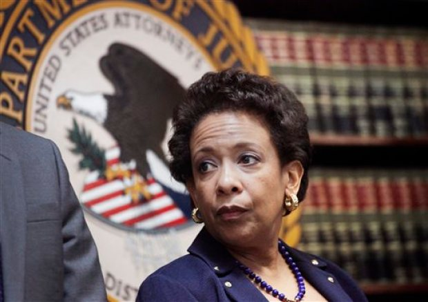 Attorney General Loretta E. Lynch announces an indictment against nine FIFA officials and five corporate executives for racketeering, conspiracy and corruption at a news conference, Wednesday, May 27, 2015, in the Brooklyn borough of New York. Nine of the 14 that were indicted by the Justice Department are soccer officials, while four are sports marketing executives and another works in broadcasting. (AP Photo/Mark Lennihan)
