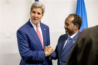 Secretary of State John Kerry meets with President Hassan Sheikh Mohammed, right, at the airport in Mogadishu, Somalia, Tuesday, May 5, 2015, in a show of solidarity with the Somalian government trying to defeat to al-Qaida-allied militants and end decades of war in the African country. He is the first secretary of state to ever to visit the country. (AP Photo/Andrew Harnik, Pool)