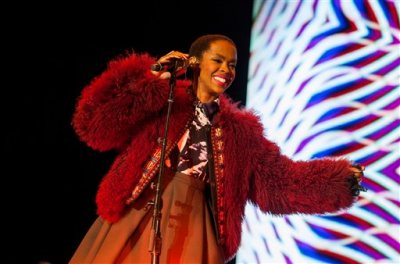 """In this Nov. 1, 2014 file photo, Lauryn Hill performs at the Voodoo Music Experience in New Orleans. Hill is canceling a planned performance in Tel Aviv because she wasn't able to schedule a concert in the Palestinian city of Ramallah. The singer-songwriter said in a statement Monday, May 4, 2015, that she originally intended to perform in both cities in hopes of being """"a presence supporting justice and peace.""""  (Photo by Barry Brecheisen/Invision/AP, File)"""