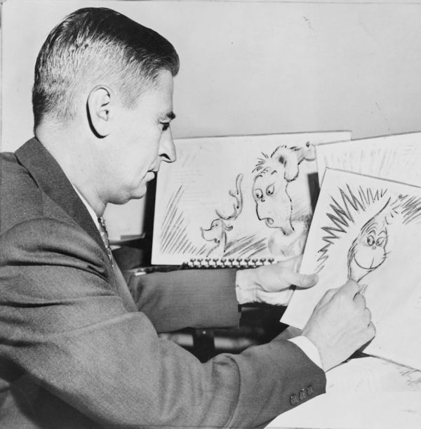 """Ted """"Dr. Seuss"""" Geisel at work on a drawing of The Grinch. (Al Ravenna, World Telegram staff photographer - Library of Congress)"""