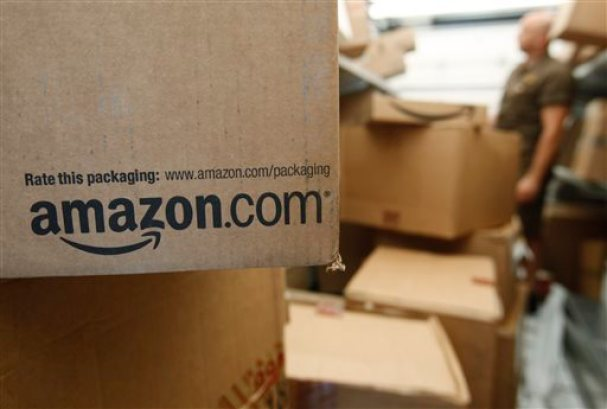 In this Oct. 18, 2010 file photo, an Amazon.com package awaits delivery from UPS in Palo Alto, Calif. Amazon on Thursday, March 13, 2014 said it is raising the price of its popular Prime membership to $99 per year, an increase of $20. It's the first price increase since the online retailer introduced its Prime membership program in 2005. (AP Photo/Paul Sakuma, File)