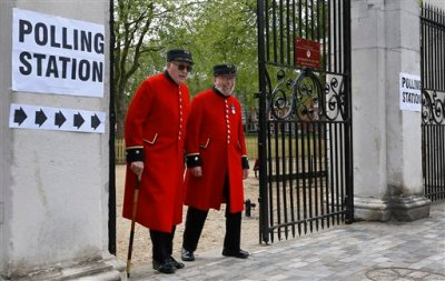 Chelsea Pensioners smile as they see the media after voting at a polling station in London, Thursday, May 7, 2015. Voting opened in Britain's national General Election Thursday, with opinion polls widely predicting an inconclusive outcome. (AP Photo/Kirsty Wigglesworth)