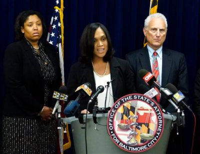 "Baltimore States Attorney Marilyn Mosby announces the indictments of six Baltimore Police officers Thursday, May 21, 2015,  on various charges related to the arrest and death of Freddie Gray. The indictments were very similar to the charges Mosby announced about three weeks ago. The most serious charge for each officer, ranging from second-degree ""depraved heart"" murder to assault, still stood. (Kevin Richardson/The Baltimore Sun via AP)"