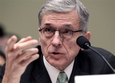 In this March 17, 2015 file photo, Federal Communications Commisison (FCC) Chairman Tom Wheeler testifies before the House Oversight and Government Reform Committee hearing on net neutrality on Capitol Hill in Washington.  Wheeler is proposing that the FCC expand a phone subsidy program for the poor to include Internet access. (AP Photo/Lauren Victoria Burke, File)