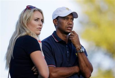 This Oct. 3, 2013 file photo shows Tiger Woods watching with his girlfriend Lindsey Vonn at the Presidents Cup golf tournament at Muirfield Village Golf Club in Dublin, Ohio. Vonn announced on Sunday, May 3, 2015, that she and Woods have decided to end their three-year relationship. (AP Photo/Darron Cummings, file)