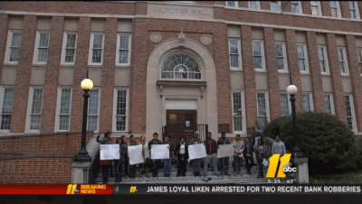 A student protest outside the erstwhile Saunders Hall in February 2015. (Screen shot/ABC 11)