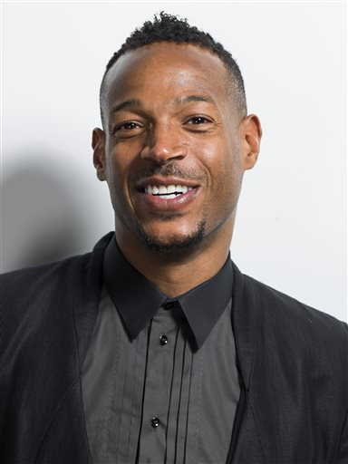 """American actor and star in the NBC network comedy series """"I Can Do That"""" Marlon Wayans poses for a portrait on Thursday, June 4, 2015, in New York. What do you get when you take one of the year's biggest box office hits - """"Fifty Shades of Grey"""" - and turn it over to funny man Wayans? Christian Grey is turning into Christian Black in Wayans' spoof of the film """"Fifty Shades of Black,"""" which has been picked up by Open Road Films for release next January. (Photo by Scott Gries/Invision/AP)"""