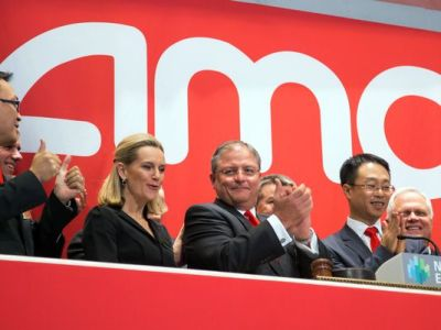 AMC Theaters President and CEO Gerry Lopez, center, is joined in applause during opening bell ceremonies to celebrate the company's IPO at the New York Stock Exchange, Wednesday, Dec. 18, 2013. (Ben Hider/AP Photo)