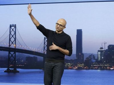 Microsoft CEO Satya Nadella waves after speaking at the Microsoft Build conference in San Francisco, Wednesday, April 29, 2015. While Microsoft has already previewed some aspects of the new Windows 10, a parade of top executives will use the conference to demonstrate more software features and app-building tools, with an emphasis on mobile devices as well as PCs. (Jeff Chiu/AP Photo)