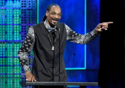 In this March 14, 2015 file photo, Snoop Dogg speaks at the Comedy Central Roast of Justin Bieber at Sony Pictures Studios in Culver City, Calif. Snoop Dogg filed a breach of contract lawsuit against Pabst Brewing Co., in Los Angeles Superior Court on Monday, June 8, 2015, seeking 10 percent of the price paid to the company last year for its Colt 45 maltbeer operations. (Photo by Chris Pizzello/Invision/AP, File)