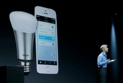 "In this June 2, 2014 file photo, Apple senior vice president of Software Engineering Craig Federighi speaks about the Apple HomeKit app at the Apple Worldwide Developers Conference in San Francisco. The first ""smart"" home gadgets that can be controlled by Apple's voice-activated digital assistant are going on sale this week, just days after rival tech giant Google announced its own software for Internet-connected home appliances and other gadgets. (AP Photo/Jeff Chiu, File)"