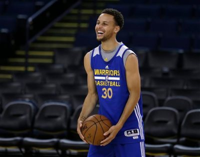 Golden State Warriors' Stephen Curry smiles during NBA basketball practice, Wednesday, June 3, 2015, in Oakland, Calif. The Warriors host the Cleveland Cavaliers in Game 1 of the NBA Finals on Thursday. (AP Photo/Ben Margot)