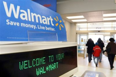 In this Feb. 17, 2009 file photo, shoppers leave a Wal-Mart in Danvers, Mass. Wal-Mart is raising starting wages for more than 100,000 U.S. department managers and workers in its deli and other specialized departments, the company said Monday, June 1, 2015. (AP Photo/Lisa Poole, File)