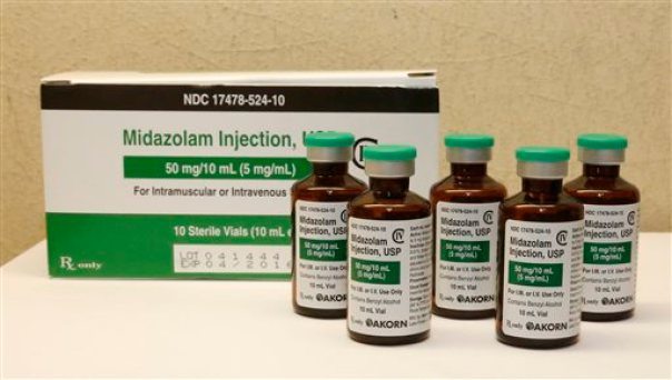This Friday, July 25, 2014 file photo shows bottles of midazolam at a hospital pharmacy in Oklahoma City. On Monday, June 29, 2015, The Supreme Court voted 5-4 in a case from Oklahoma saying that the sedative midazolam can be used in executions without violating the Eighth Amendment prohibition on cruel and unusual punishment. (AP Photo/Sue Ogrocki, File)
