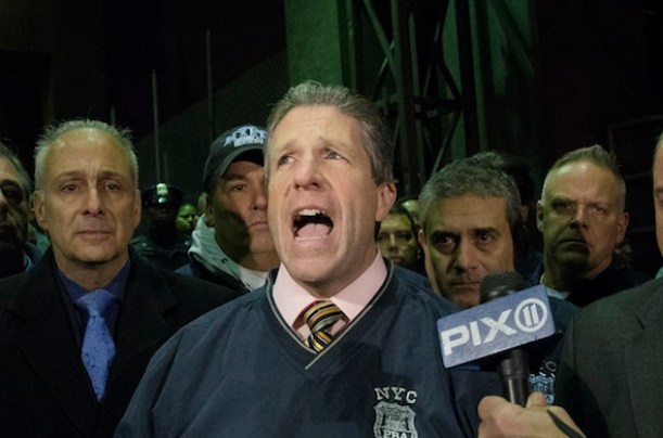 Patrick Lynch, head of the Patrolmen's Benevolent Association, speaks during a news conference after the bodies of two fallen NYPD police officers were transported from Woodhull Medical Center, Saturday, Dec. 20, 2014, in New York. An armed man walked up to two New York Police Department officers sitting inside a patrol car and opened fire Saturday afternoon, killing both officers before running into a nearby subway station and committing suicide, police said. (AP Photo/John Minchillo)