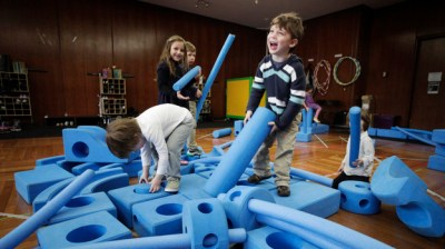Children play with blue foam building blocks at the Blue School in New York City on March 31. The private preschool was founded by members of the Blue Man Group who wanted to send their own children to a school they felt supported creativity. (AP Photo)
