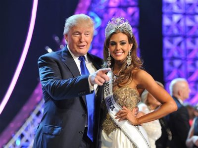 """In this June 16, 2013 file photo, Donald Trump, left, and Miss Connecticut USA Erin Brady pose onstage after Brady won the 2013 Miss USA pageant in Las Vegas, Nev. Univision says it is dropping the Miss USA Pageant and says it will cut all business ties with Donald Trump over comments he made about Mexican immigrants. The network said Thursday, June 25, 2015, it will not air the pageant on July 12, as previously scheduled, and has ended its business relationship with the Miss Universe Organization due to what it called """"insulting remarks about Mexican immigrants"""" by Trump, a part owner. (AP Photo/Jeff Bottari, File)"""
