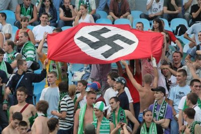 In this photo taken Aug. 19, 2007 soccer fans show a German Nazi flag with a swastika during an Ukrainian League Championship soccer match between Dynamo Kyiv and Karpaty in Kiev, Ukraine. With the defeat of Adolf Hitler in 1945, the Nazi's scarlet flag with a black swastika was banned in Germany and remains so today.  The banner once hung from all official buildings in the Third Reich, was waved madly by the cheering crowds that supported Hitler and the Nazis, and was an integral part of military and other uniforms. Synonymous with the genocidal policies of the Nazis, the flag, the swastika and all other such symbols are illegal to display today, but remain favorites of neo-Nazis and other right-wing extremists, both inside Germany and around the world. After the war, the swastika was chiseled out of the talons of the stylized stone eagle that featured on many Nazi buildings, but today there is now a debate about whether the bird itself should go as well. (Ukrinform via AP)