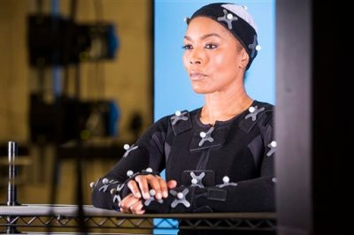"""This undated photo provided by Ubisoft shows actress Angela Bassett during a motion capture session for her character, in the video game, """"Rainbow Six: Siege."""" The actress and filmmaker is taking on the mantle of """"Six,"""" the codename for the leader of the elite counter-terrorism group depicted in """"Tom Clancy's Rainbow Six."""" Bassett was unveiled Monday, June 15, 2015, during Ubisoft's press conference at the Electronic Entertainment Expo as the latest """"Six"""" in the upcoming """"Rainbow Six: Siege"""" installment of the publisher's long-running shooter series.   (Colin Young-Wolff/Ubisoft via AP)"""