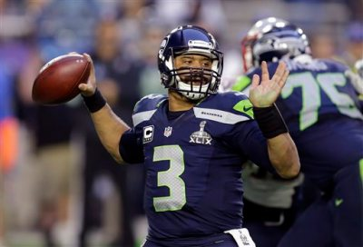 In this Feb. 1, 2015, file photo, Seattle Seahawks quarterback Russell Wilson (3) throws a pass during the first half of NFL Super Bowl XLIX football game against the New England Patriots in Glendale, Ariz. Wilson tweeted Friday morning, July 31, 2015, that he has agreed to a four-year contract extension with the Seahawks, keeping him with the franchise that took him in the third round of the 2012 draft and watched him become one of the most successful young quarterbacks in NFL history. (AP Photo/Ben Margot, File)