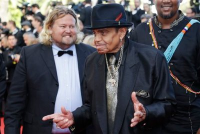 In this Friday, May 23, 2014 file photo, Joe Jackson arrives for the screening of Sils Maria at the 67th international film festival, Cannes, southern France. A Brazilian hospital says Joe Jackson — the father of the late Michael Jackson and the patriarch of the musical family — suffered a stroke while visiting the South American nation. An emailed statement early Monday, July 27, 2015 from the Albert Einstein hospital in Sao Paulo says only that Jackson was admitted to the hospital Sunday afternoon. He is in the intensive care unit. (AP Photo/Thibault Camus, file)