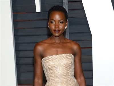 "In this Feb. 22, 2015 file photo, Lupita Nyong'o arrives at the 2015 Vanity Fair Oscar Party in Beverly Hills, Calif. Nyong'o, the Oscar-winner for her role in Steve McQueen's ""12 Years A Slave"" will make her New York stage debut in September. The Public Theater said Thursday that Nyong'o will star in ""Eclipsed,"" a story of survival and resilience set in post-colonial Africa.  (Photo by Evan Agostini/Invision/AP, File)"