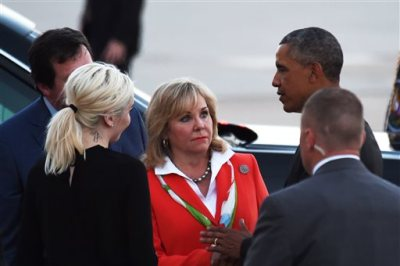 President Barack Obama, right, talks with Oklahoma Gov. Mary Fallin, center, after arriving at Tinker Air Force Base, Wednesday, July 15, 2015, in Oklahoma City, Okla. (AP Photo/Tyler Drabek)