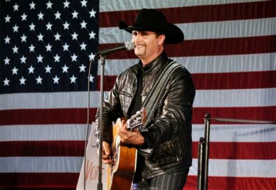 In this Nov. 2, 2009 file photo, John Rich of the musical group, Big & Rich, performs at a rally for 23rd Congressional District candidate, Doug Hoffman, in Watertown, N.Y. Mainstream country music has been quietly distancing itself from the Confederate flag for years, but as the debate reignites following a massacre at a black church in South Carolina on June 17, country artists still struggle to articulate their feelings about the flag's history and symbolism. Rich told Fox News' Sean Hannity that he agreed with South Carolina Gov. Nikki Haley's call to remove the Confederate flag from the state capitol. (AP Photo/Heather Ainsworth, File)