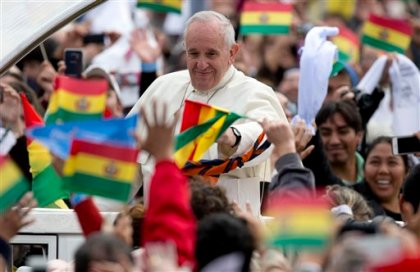 Pope Francis waves from his popemobile as he arrives to celebrate Mass at Christ the Redeemer square in Santa Cruz, Bolivia, Thursday, July 9, 2015. After the Mass, Francis' main event of the day is a keynote speech to a summit of grass-roots groups whose advocacy for the poor and marginalized has been championed by history's first Latin American pope. (AP Photo/Eduardo Verdugo)