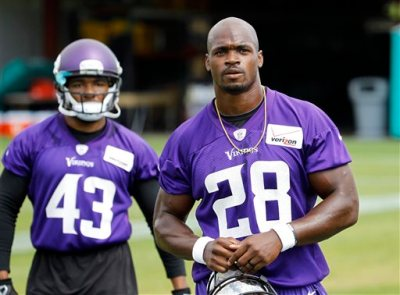 In this Wednesday, June 17, 2015,  file photo, Minnesota Vikings running back Adrian Peterson (28) walks across the field during NFL football minicamp in Eden Prairie, Minn. The sideshow that overshadowed last season has been dismantled, following Peterson's reinstatement from NFL suspension. (AP Photo/Ann Heisenfelt, File)
