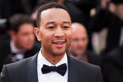 """In this May 13, 2015 file photo, John Legend arrives for the opening ceremony and the screening of the film """"La Tete Haute"""" (Standing Tall), at the 68th international film festival, Cannes, southern France. Legend is bringing his talents to a TV drama about Southern slaves fighting for freedom. WGN America said Wednesday, July 29, 2015, that Legend and his production company will be in charge of the score and soundtrack for """"Underground.""""  (Photo by Arthur Mola/Invision/AP, File)"""
