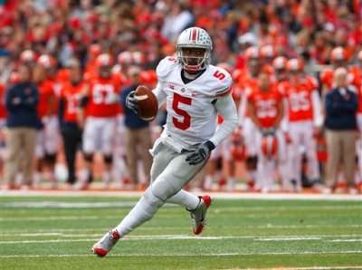 in this Nov. 16, 2013, file photo, Ohio State quarterback Braxton Miller (5) runs against Illinois during an NCAA college football game in Champaign, Ill. Miller is shifting from quarterback to receiver, whittling Ohio State's QB competition to two star passers. Miller told SI.com on Thursday night, July 23, that he plans to start the season in the H-back position and also hopes to return punts. He had surgery to repair of torn labrum in his throwing shoulder before the start of last season. (AP Photo/Jeff Haynes, File)