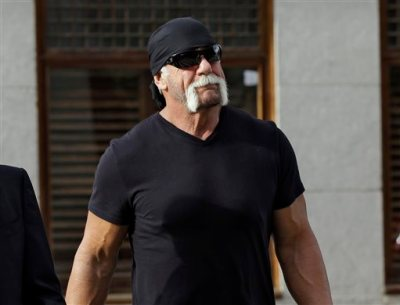 """In this Oct. 15, 2012 file photo, former professional wrestler Hulk Hogan, whose real name is Terry Bollea, arrives for a news conference at the United States Courthouse in Tampa, Fla. World Wrestling Entertainment Inc. has severed ties with Hogan. The company did not give a reason, but issued a statement Friday, July 24, 2015, saying it is """"committed to embracing and celebrating individuals from all backgrounds as demonstrated by the diversity of our employees, performers and fans worldwide.""""  (AP Photo/Chris O'Meara, File)"""