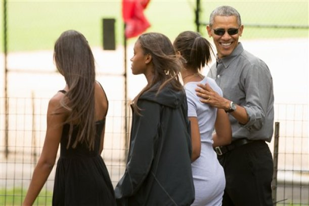 President Barack Obama, accompanied by his daughter, Sasha, second from right, and her friends, walks through Central Park in New York, Saturday, July 18, 2015. Obama is spending a mainly personal weekend with his daughters in New York City. (AP Photo/Andrew Harnik)