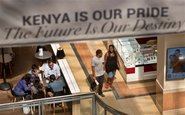 Shoppers return to the reopened Westgate Shopping Mall, nearly two years after a terrorist attack there left at least 67 people dead, in the capital Nairobi, Kenya Saturday, July 18, 2015. Hundreds of shoppers thronged through the reopened mall Saturday, following two years of repairs after security forces battled four gunmen from Somalia's al-Qaida-linked al-Shabab militant group there in September 2013. (AP Photo/Ben Curtis)