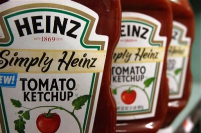 FILE - This March 2, 2011, file photo, shows containers of Heinz ketchup on the shelf of a market, in Barre, Vt.  Kraft shareholders have approved the sale of the company to ketchup maker H.J. Heinz, creating one of the world's largest food companies with annual revenue of about $28 billion. (AP Photo/Toby Talbot, File)