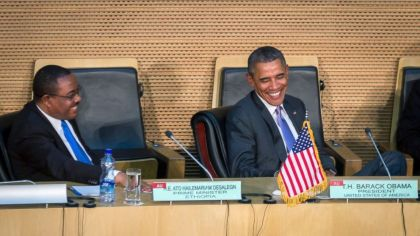 President Barack Obama smiles as he listens to Ethiopia's Prime Minister Hailemariam Desalegn, left, before Obama delivered a speech to the African Union in Addis Ababa, Ethiopia Tuesday, July 28, 2015. Closing a historic visit to Africa, President Barack Obama on Tuesday urged the continent's leaders to prioritize creating jobs and opportunity for the next generation of young people or risk sacrificing future economic potential to further instability and disorder. (AP Photo/Mulugeta Ayene)