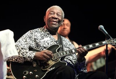 In this Aug. 8, 2013 file photo, Blues music legend B.B. King performs on Frampton's Guitar Circus 2013 Tour at Pier Six Pavilion, in Baltimore. The coroner in Las Vegas says there's no evidence King was poisoned before he died of natural causes in May 2015. Clark County Coroner John Fudenberg said Monday, July 13, 2015, that an autopsy sought by two of the musical icon's 11 adult children came back cause of death alzheimers disease with other significant conditions. (Photo by Owen Sweeney/Invision/AP, File)