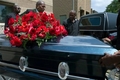 The casket of Samuel Dubose is transported to a hearse during his funeral at the Church of the Living God in the Avondale neighborhood of Cincinnati, Tuesday, July 28, 2015. Dubose was fatally shot by a University of Cincinnati police officer who stopped him for a missing license plate. (AP Photo/John Minchillo)